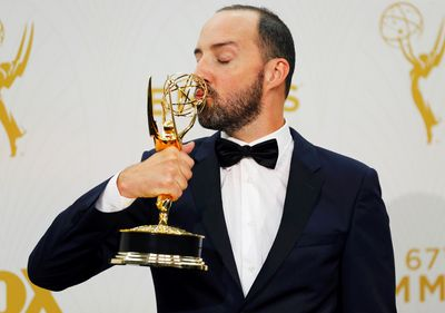 """Actor Tony Hale kisses his award for Outstanding Supporting Actor In A Comedy Series for the HBO series """"Veep"""" backstage during the 67th Primetime Emmy Awards in Los Angeles, California September 20, 2015.  REUTERS/Mike Blake"""