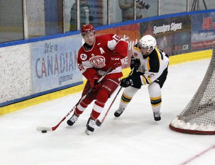 STEPHEN UHLER / DAILY OBSERVER Pembroke Lumber King Jesse Blais (16) whips around Smiths Falls net while pursued by Bear Johnny Kyte (2) during Sunday's CCHL game at the Pembroke Memorial Centre.