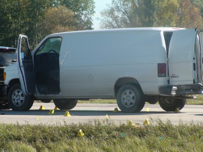Manitoba's independent investigation unit investigate a scene just north of Winnipeg on Highway 59 near Highway 44 on Sept. 21, 2015. Winnipeg police officers shot and killed a 44-year-old man at the scene. (JIM BENDER/WINNIPEG SUN/POSTMEDIA NETWORK PHOTO)