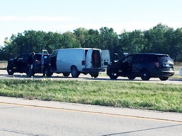 Manitoba's independent investigation unit investigate a scene just north of Winnipeg on Highway 59 near Highway 44 on Sept. 21, 2015. Winnipeg police officers shot and killed a 44-year-old man at the scene. (DENNIS FUERST/SELKIRK JOURNAL/POSTMEDIA NETWORK PHOTO)