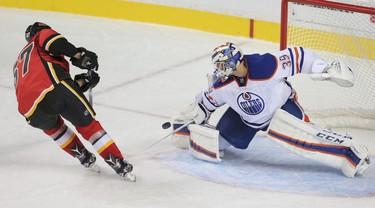 Anders Nilsson from the Edmonton Oilers makes a save on the Calgary Flames Michael Frolik on a penalty shot in pre-season NHL hockey action at the Scotiabank Saddledome in downtown Calgary, Alta. on Monday September 21, 2015. Stuart Dryden/Calgary Sun/Postmedia Network
