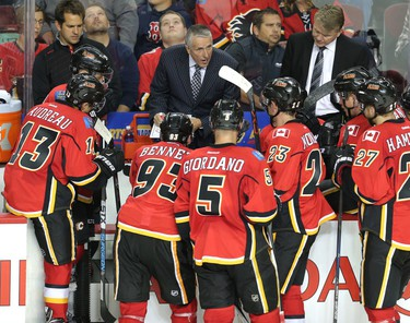 Head Coach Bob Hartley has a word with his players from the Calgary Flames in the dying minutes of a game agaisnt the Edmonton Oilers in pre-season NHL hockey action at the Scotiabank Saddledome in downtown Calgary, Alta. on Monday September 21, 2015. Flames lost 3-1 to the Oilers. Stuart Dryden/Calgary Sun/Postmedia Network