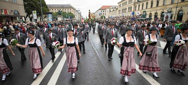 People dressed in traditional Bavarian clothes take part in the Oktoberfest parade in Munich, Germany, September 20, 2015. Millions of beer drinkers from around the world will come to the Bavarian capital over the next two weeks for the 182nd Oktoberfest, which runs until October 4, 2015. REUTERS/Lukas Barth