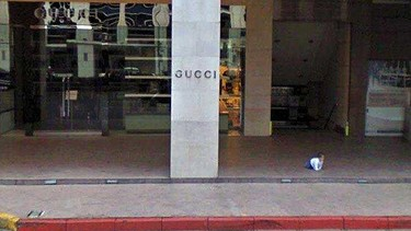 This baby wandered out of the Gucci store without his parents. (Google)