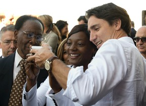 Liberal leader Justin Trudeau takes a selfie with a supporter during a campaign stop in Montreal, on Sept. 22, 2015. (THE CANADIAN PRESS/Adrian Wyld)