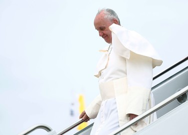 Pope Francis descends the stairs of the papal plane after arriving in the United States at Joint Base Andrews outside Washington September 22, 2015. REUTERS/Tony Gentile