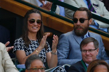 Pippa Middleton, the sister of Kate, the Duchess of Cambridge and her brother James Middleton watch on Centre Court, during the women's semifinal match between Garbine Muguruza of Spain and Agnieszka Radwanska of Poland, at the All England Lawn Tennis Championships in Wimbledon, London, Thursday July 9, 2015. (AP Photo/Alastair Grant)