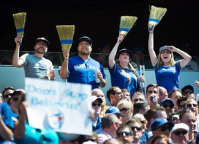 Fans celebrate the Toronto Blue Jays' series sweep of the Oakland Athletics during MLB baseball action in Toronto on Aug. 13, 2015. (THE CANADIAN PRESS/Darren Calabrese)