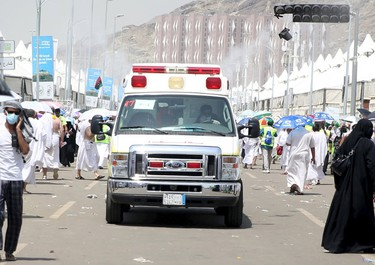 An ambulance evacuates victims following a crush caused by large numbers of people pushing at Mina, outside the Muslim holy city of Mecca September 24, 2015. The death toll from a stampede during the annual Muslim hajj pilgrimage in Saudi Arabia on Thursday has risen to 453 people of various nationalities, the Saudi civil defence said. REUTERS/Stringer