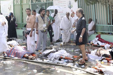 The bodies of Muslim pilgrims are seen following a crush caused by large numbers of people pushing at Mina, outside the Muslim holy city of Mecca September 24, 2015. The death toll from a stampede during the annual Muslim hajj pilgrimage in Saudi Arabia on Thursday has risen to 453 people of various nationalities, the Saudi civil defence said. REUTERS/Stringer