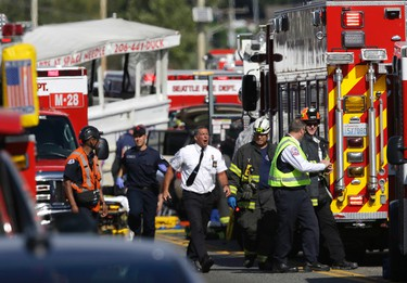 Emergency personnel respond at the scene of a crash involving a charter bus and amphibious tour vehicle Thursday, Sept. 24, 2015 in Seattle. Seattle fire officials say two people have been killed and numerous others critically injured in the crash that happened on a bridge over Lake Union.  (AP Photo/Ted S. Warren)