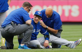 When last we saw Troy Tulowitzki, he was reacting after a collision with teammate Kevin Pillar. Tulo could be back next week, manager John Gibbons said Thursday. (KATHY WILLENS/AP files)