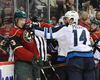 Sep 27, 2015; Saint Paul, MN, USA:  Minnesota Wild center Tyler Graovac (53) and Winnipeg Jets forward Anthony Peluso (14) exchange words during the second period at Xcel Energy Center. Mandatory Credit: Marilyn Indahl-USA TODAY Sports