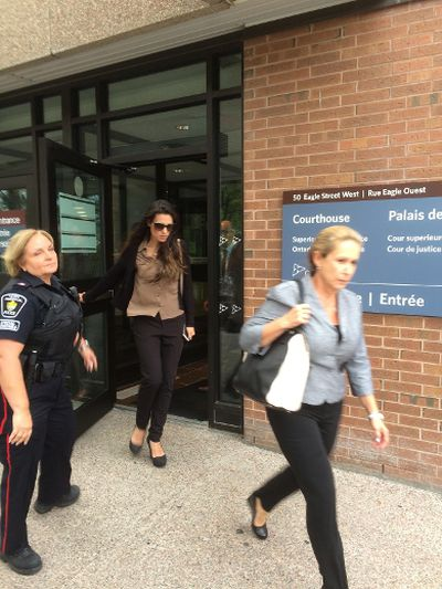 Marco Muzzo's mother, right, and fiancee leave Newmarket court after his appearance on Monday, Sept. 28, 2015. (SAM PAZZANO/Toronto Sun)