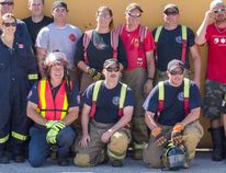 Kincardine and Tiverton firefighters take part in training simulations of a school bus accident. Following the completion of training, volunteer firefighters line against a school bus on its side for a photo. Back L to R: Steve Otterman, Keith Virtue, Craig Palmateer, Kyle Jenkins, Shane Watson, Paula Turner, Brian Young, Matt McKenzie, Josh Kunkel, Greg Simmons and OPP Kevin Martin. Middle row standing, from L to R: Dwayne Sheppard and Colleen Craig. Front row, kneeling: Ron Simmons, Andy McIntosh, Matt Stanley and Kent Padfield. (Darryl Coote/Kincardine News)