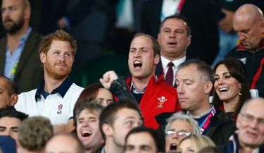 Prince Harry and Prince William and Catherine, Duchess of Cambridge in the stands at the IRB Rugby World Cup 2015, England versus Wales, Twickenham Stadium, London, England. Reuters/Andrew Winning