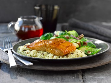 Pan steamed and seared honey salmonIngredients:1/4 cup (60 mL) rice wine vinegar 3 Tbsp. (45 mL) light soy sauce 3 Tbsp. (45 mL) liquid honey 1 Tbsp. (15 mL) vegetable oil 1 cup (250 mL) reduced sodium vegetable broth 1 lb (500 g) salmon fillets, skinless, cut into 4 portionsDirections:  In large self-seal bag, combine rice wine vinegar, soy sauce and liquid honey. Mix well. Reserve half for use later in recipe. Add salmon fillets to marinade in self-seal bag. Marinate in refrigerator for 4 to 24 hours. In a large skillet, heat vegetable oil over medium-high heat. Add salmon and sear 1 minute per side. Discard leftover marinade. In saucepan, bring vegetable broth to a boil. Place bamboo steamer (or similar steamer) over boiling broth. Transfer seared salmon into steamer. Cover and steam 2 -3 minutes or until salmon reaches an internal temperature of 140°F (80°C). Meanwhile, in same skillet, reduce heat to medium. Add reserved marinade and bring to boil. Continue to boil for 1 to 2 minutes or until thickened and reduced by half, stirring constantly. To serve, spoon glaze over each salmon filet. Serves 4.