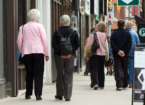 Senior citizens make their way down a street in Peterborough, Ont., on May 7, 2012. Statistics Canada says the country's population now features more seniors than children. (THE CANADIAN PRESS/Frank Gunn)