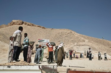 Egyptian laborers work at the entrance of the Valley of the Kings in Luxor, Egypt, Tuesday, Sept. 29, 2015.  (AP Photo/Nariman El-Mofty)