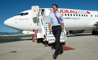 Liberal Leader Justin Trudeau walks on the tarmac away from the party's campaign plane in Vancouver on Tuesday, September 29, 2015. THE CANADIAN PRESS/Paul Chiasson