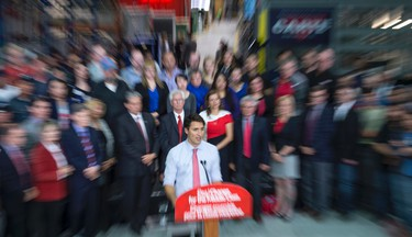 Liberal leader Justin Trudeau addresses workers and supporters as he tours an electric transformer manufacturer Tuesday, September 29, 2015 in Winnipeg. THE CANADIAN PRESS/Paul Chiasson