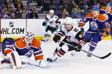 Edmonton goaltender Anders Nilsson (39) and Arizona centre Max Domi (16) watch a flying puck during the second period of an NHL game between the Edmonton Oilers and the Arizona Coyotes at Rexall Place in Edmonton, Alta. on Tuesday September 29, 2015. Ian Kucerak/Edmonton Sun/Postmedia Network