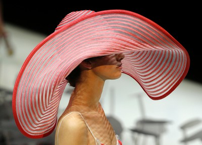 """A model wears a creation for Giorgio Armani women's Spring-Summer 2016 collection, part of the Milan Fashion Week, unveiled in Milan, Italy, Monday, Sept. 28, 2015. (AP Photo/Antonio Calanni)  PDRTJS_settings_8247000 = { """"id"""" : """"8247000"""", """"unique_id"""" : """"default"""", """"title"""" : """""""", """"permalink"""" : """""""" }; (function(d,c,j){if(!document.getElementById(j)){var pd=d.createElement(c),s;pd.id=j;pd.src=('https:'==document.location.protocol)?'https://polldaddy.com/js/rating/rating.js':'http://i0.poll.fm/js/rating/rating.js';s=document.getElementsByTagName(c)[0];s.parentNode.insertBefore(pd,s);}}(document,'script','pd-rating-js'));"""