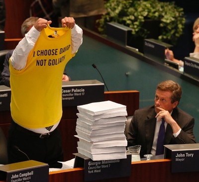 Councillor Giorgio Mammoliti removes his shirt on orders of the speaker before presenting 7,000 petitions at the taxi debate Wednesday September 30, 2015. (Michael Peake/Toronto Sun)