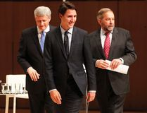 Liberal Leader Justin Trudeau, left to right, Conservative Leader Stephen Harper and NDP Leader Tom Mulcair leave the stage following the Munk Debate on Canada's foreign policy in Toronto, on Monday, Sept. 28, 2015. THE CANADIAN PRESS/POOL-Fred Thornhill