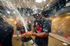 St. Louis Cardinals' Jason Heyward pops the cork on a bottle of champagne after the Cardinals clinched the Central Division in Pittsburgh, Wednesday, Sept. 30, 2015. (AP Photo/Gene J. Puskar)