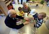 John and Betty Boutillier play with Primrose Day Care children at Ottewell Terrace in Edmonton on Wednesday. The seniors residence is an inter-generational housing project. (Perry Mah/Edmonton Sun)