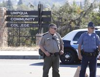 Police officers stand guard near the site of a mass shooting at Umpqua Community College in Roseburg, Oregon October 1, 2015. A gunman opened fire at a community college in southern Oregon on Thursday, killing 13 people and wounding some 20 others before he was shot to death by police, state and county officials said, in the latest mass killing to rock a U.S. school. There were conflicting reports on the number of dead and wounded in the shooting rampage in Roseburg, which began shortly after 10:30 a.m. local time (1730 GMT). REUTERS/Steve Dipaola