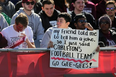 A University of Ottawa Gee-Gees fan holds up a sign during the annual Panda Game against the Carleton Ravens at TD Place on Saturday, Oct. 3 2015 (Chris Hofley/Ottawa Sun)