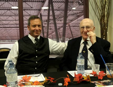 Former NHL goaltender Clint Malarchuk, left, a Grande Prairie, Alta, native, shares a moment with his uncle Max Henning Saturday during Malarchuk's induction into the Grande Prairie Hockey Legends, at the Legends Lounge, inside the Coca-Cola Centre. Malarchuk became the 23rd member of the Grande Prairie Hockey Legends, joining his Uncle Max. Logan Clow/Daily Herald-Tribune