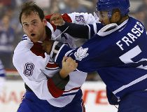 Mark Fraser of the Toronto Maple Leafs fights with Zack Kassian of the Montreal Canadiens during preseason NHL action at the Air Canada Centre in Toronto on Saturday September 26, 2015. Dave Abel/Toronto Sun