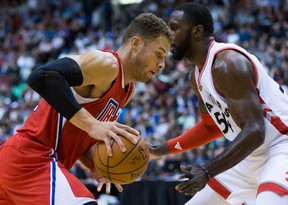 Los Angeles Clippers' Blake Griffin, left, drives to the basket past Toronto Raptors' Patrick Patterson during the first half of a pre-season NBA basketball game in Vancouver, B.C., on Sunday October 4, 2015. THE CANADIAN PRESS/Darryl Dyck