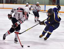 Travis Walker of the Port Dover Sailors prepares to stickhandle around Dundas defender Cam Docherty during Sunday's Niagara District Jr. C game in Port Dover. The Sailors won the cliffhanger by a score of 7-5. (MONTE SONNENBERG Simcoe Reformer)