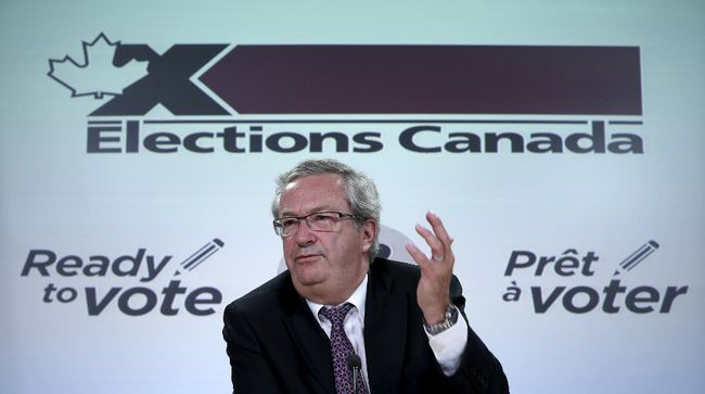 Canada's Chief Electoral Officer Marc Mayrand speaks during a news conference in Ottawa. 