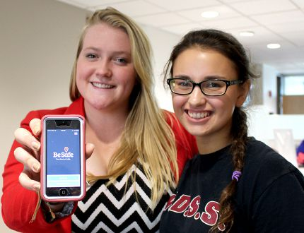 Katie Brandon-Wheeler, 18, a Grade 12 student at St. Patrick high school in Sarnia, Ontario, and Bridget Peters, 16, a Grade 11 student at Wallaceburg District Secondary School, display the new BeSafe App that is available free to students in both the Lambton Kent and St. Clair Catholic district school boards. Photo taken in Wallaceburg, Ont. on Monday October 5, 2015. (Ellwood Shreve, The Daily News)