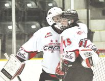 Central Plains midget Capitals goalie Duncan McGovern, left, and forward Brody Moffat embrace following the team's 3-1 win over the Brandon Wheat Kings Sunday at the PCU Centre. The Capitals went 2-0 on opening weekend in the Manitoba Midget AAA Hockey League, winning their opener 6-2 over Pembina Valley Saturday. (Matt Hermiz/TheGraphic/Postmedia Network)