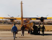 A Canadian Forces CC-138 Twin Otter search and rescue plane unloads at Grande Prairie Airport on Monday. The plane and crew, from Yellowknife, are taking part in a large-scale search and rescue training exercise based out of the airport this week. Tom Bateman/Daily Herald-Tribune