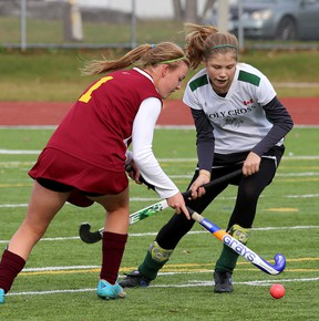 Regiopolis-Notre Dame Panthers' Lilly Dickson, left, and Holy Cross Crusaders' Jewel Neill battle for the ball during the 2014 high school girls field hockey final at the Invista Centre last October. Holy Cross is 5-0 this season and Regi is 4-0. (Whig-Standard file photo)