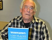 Andrew Armitage and his new book Vanishing: Lost Places in Grey and Bruce, which will be launched Wednesday evening at the Roxy Theatre. (Rob Gowan The Sun Times)