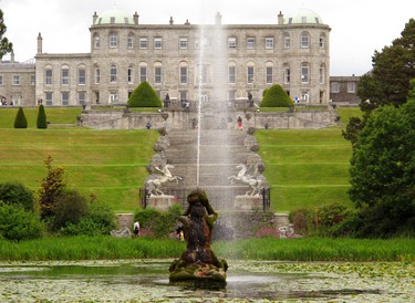 This June 14, 2015 photo shows the exterior of Powerscourt House in County Wicklow, Ireland. The 18th century estate has vast ornate gardens reminiscent of Versailles that were named among the most beautiful in the world by National Geographic magazine. A fire destroyed much of the interior of the house, but visitors can spend an entire day exploring the grounds _ over 47 acres of formal gardens, sweeping terraces, statues, ornamental lakes and trails.(Helen O'Neill via AP)