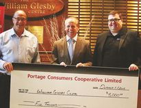 Portage Co-op GM Kevin Dales (left) presents Craig Dunn (middle), chair of Glesby Centre board and Chris Kitchen (right), executive director of the Glesby Centre with a donation to go towards roof repairs Oct. 1 at the Glesby Centre. (Brian Oliver/The Graphic/Postmedia Network)