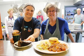 Lunch is served at the Inn of the Good Shepherd's soup kitchen Tuesday in Sarnia. A Thanksgiving-themed meal is on tap for the Inn's annual Harvest Dinner fundraiser Wednesday. Pictured with the prepared food are volunteers Bridget Seabrook, left, and Jane Dolinsek, two in a group of seven who were preparing the Tuesday meal. Tyler Kula/Sarnia Observer/Postmedia Network