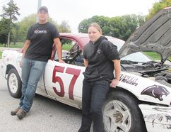 Roper Beaumont, left, and Harlie Hornick were the lead students for the John McGregor Secondary School race car project. The students built the car as part of a high school challenge program offered by Delaware Speedway. The students retired the car Tuesday and are now getting ready to work on another vehicle for the next racing season. Photograph taken at Chatham, Ontario on Tuesday, Oct. 6, 2015 (Blair Andrews, Postmedia Network)
