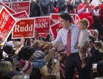 Liberal leader Justin Trudeau holds his son Hadrien as he exits a campaign rally in Brampton, Ontario, Canada October 4, 2015. (REUTERS/Mark Blinch)