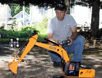Mario Perron finds his R/C park at his east-end home to be a great stress reliever.