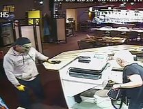 Surveillance photo of one of the suspects in an armed robbery at the Jackpot Grill, Oct. 5, 2015 Supplied